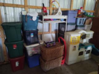 Numerous plastic totes of miscellaneous items; children's toys & shelving unit
