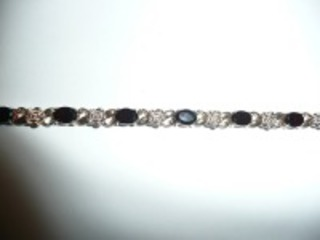 PRETTY STERLING SILVER BRACELET WITH DEEP RED STONES