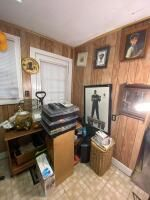 Salvage Lot Including Framed Art, VHS Tapes, Etc. Buyer Responsible for Removal