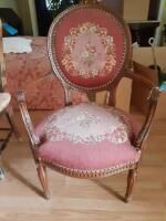 Wooden chair with designs engraved throughout including back cushioning