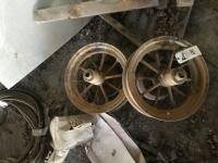 Pair. Of Round Spoke Wheels