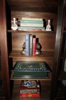 ALL ITEMS INSIDE CHINA CABINET INCLUDING BOOKS, BOOKENDS, GAMES, AND PORCELAIN SMALLS - USHALL