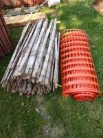 One new roll of safety fence and one wood picket snow fence