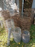 2 partial rolls of new barbed wire, approx. 10-ft hog gate, some new woven wire, some new round top yard fence, wire hardware cloth old used wire chicken wire, auger corn tunnels