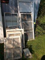 Variety of old 4 pane and 2 pane windows, two aluminum storm doors, screen door insert and a storm door insert various sizes