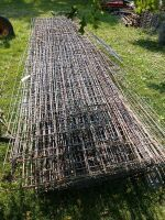 24 + hog panels variety of different links, some cut down to 4 ft but the majority appear to be 16 ft all piled up count is conservative