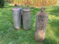 Four 100 pound LP tanks