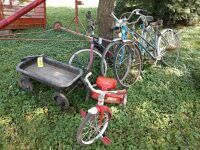 Classic stylized coaster wagon large child's tricycle and three bicycles