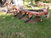 Case four bottom moldboard plow with buster bar harrow