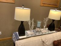 "Modern glass top sofa table measures 55"" L x 27"" H - 2 lamps, runner and decor included as well"