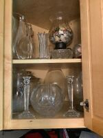 Lot of glassware: some of which are Mikasa, vases, pitcher, wine decanter, candlesticks, candy jars, centerpiece and more.