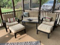 Patio set including: love set, two chairs and ottomans, coffee table and ashtray, rug not included