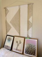 Three pieces of modern and succulent art and a modern geometric wall hanging