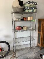 Garage utility shelf with chair cushions, litter box, candles and other misc.