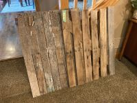 "Barn wood style wall hangings measure 27"" wide x 37"" high"
