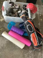 Tote full of rollerblades, helmets and yoga mats, exercise roller travel pillow, balance board, youth golf clubs