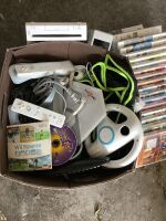 Wii gaming console, steering wheel, controllers, and a nice variety of Wii games