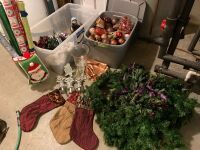 Large lot of Christmas decor including: wrapping paper, stockings, stocking hangers, bulbs, lights, other decor pieces
