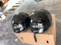 Two like-new HJC helmets with pull down sun visors, size small and size medium, small scratches