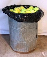 Galvanized Can Full of Tennis Balls