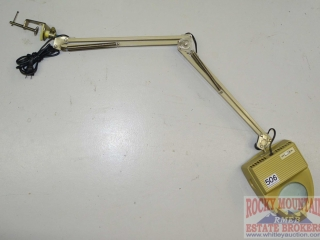 Clamp On Lighed Magnifier.