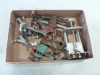 assortment of pullers and vises