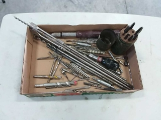 assortment of drill bits and punches