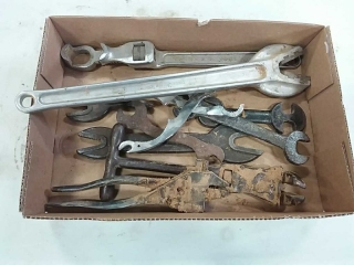 assortment of antique wrenches