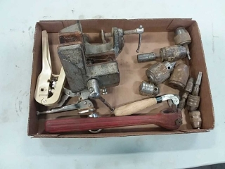 assortment of chucks, bench vise, wheel sharpener