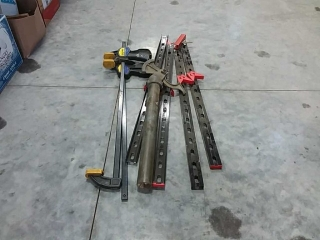 assortment of clamps, jigs, bender