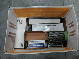 assortment of staples, threading kit, belts