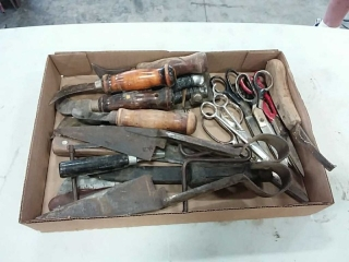 assortment of hand tools and scissors