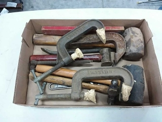 assortment of C clamps, hammers, hand tools