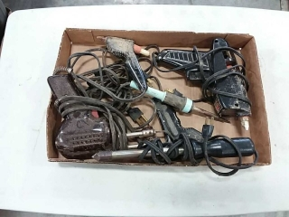 assortment of glue guns and soldering irons