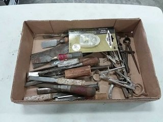assortment of hand tools, chissels