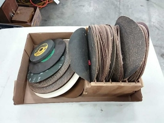 assortment of sanding disc and grinding wheels