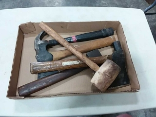assortment of hmmers and hatchets