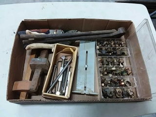 assortment of hand tools and copper fittings