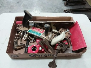 assortment of hand tools and clamps