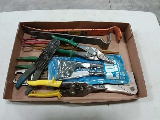 assortment of hand tools, pry bars, clippers,