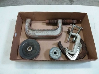 assortment of C-clamps and pulleys