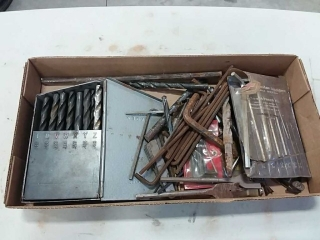 assortment of drill bits and allen wrenches