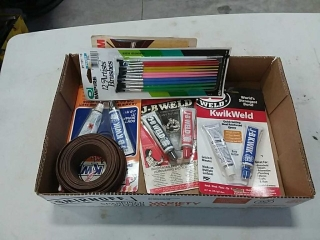 assortment of JB weld, wire, brushes