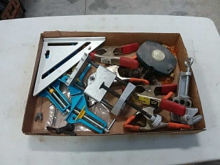 assortment of clamps, vise, speed square