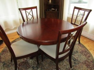 Dining room table with one leaf and  4 chairs