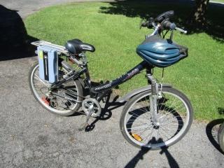 Schwinn  Invidia  Electric Bicycle with helmet  26