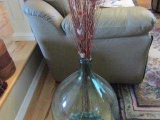 Pair of large bottle/vases with floral arrangement