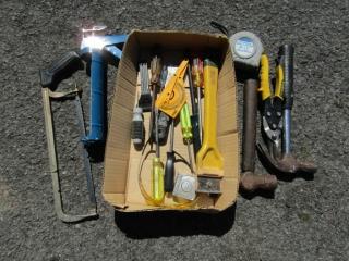 Box lot: assorted hand tools,: caulking gun, rules