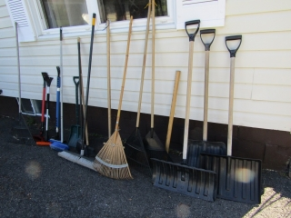 Group of garden implements and sledge hammer