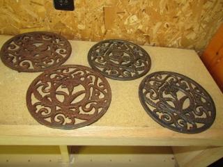 """4 cast iron trivets floral designs 6.75"""" D"""